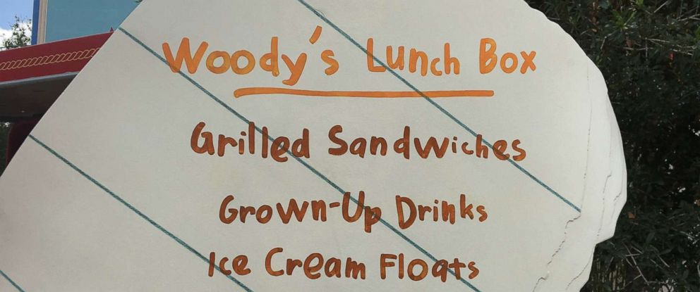 PHOTO: A sign outside Woody's Lunch Box at Disney's Toy Story Land at the Walt Disney World Resort in Bay Lake, Fla., near Orlando, lists food options at Woodys Lunch Box.