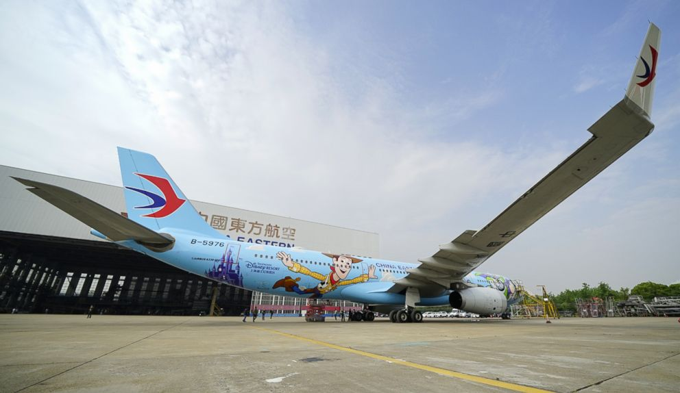 A Toy Story themed plane is taking off in China. The plane is a collaboration between Disney-Pixar and China Eastern Airlines. It has Buzz and Woody painted on the exterior and it  has familiar movie characters in the interior.