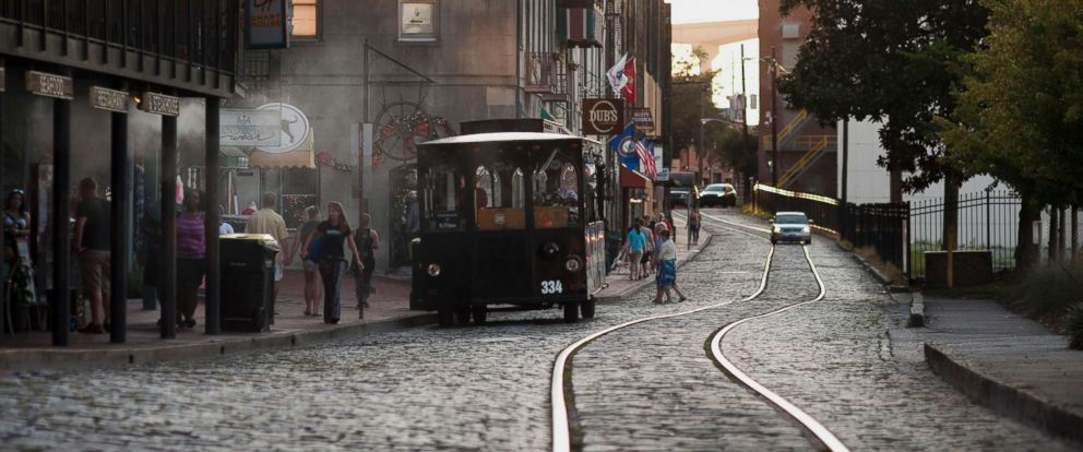 PHOTO: A trolley stops to pick up passengers on River Street in Savannah, Ga., Aug. 15, 2015.