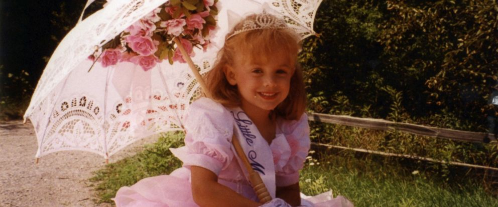 PHOTO: JonBenet is pictured here in an undated photo riding on the back of a car for a local parade.