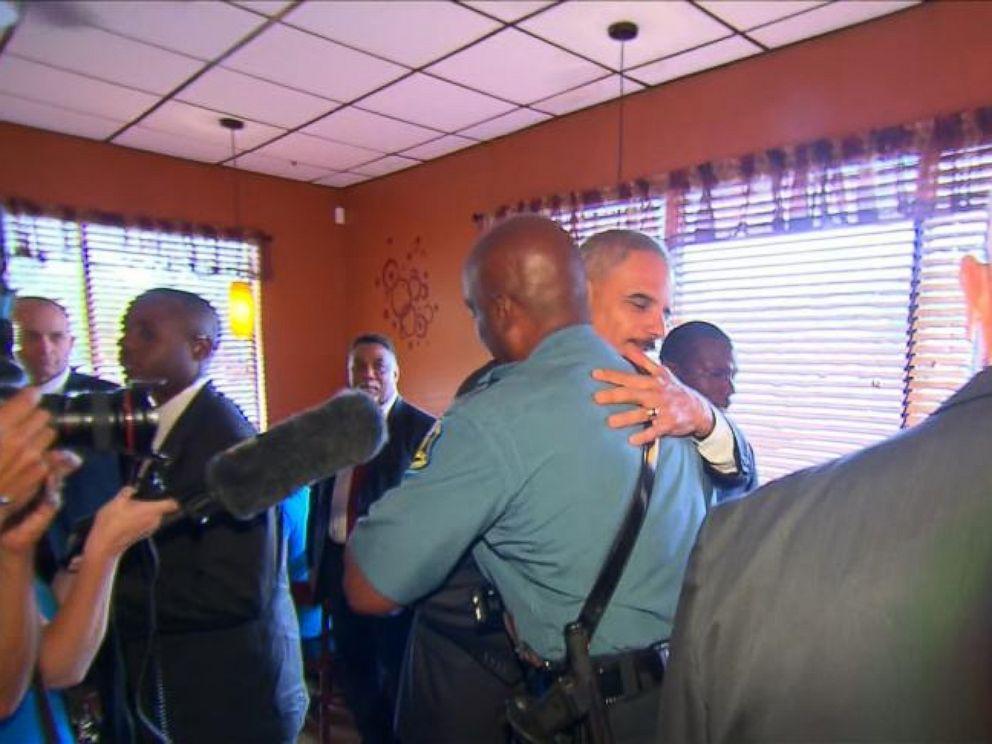 Attorney General Eric Holder greets Captain Ron Johnson in Ferguson, Mo., Aug. 20, 2014.