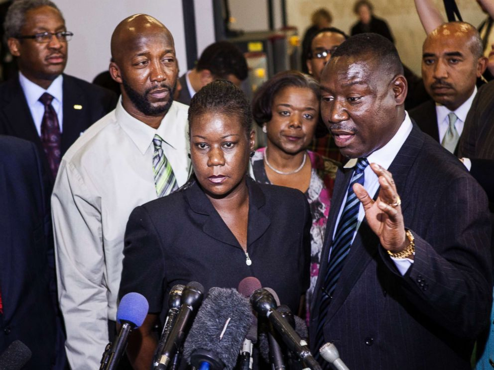 PHOTO: Sybrina Fulton (C) and Tracy Martin (L), parents of Trayvon Martin, listen while their friend and lawyer Benjamin Crump speaks to the press after a forum of Democratic members of the House Judiciary Committee on Capitol Hill March 27, 2012.