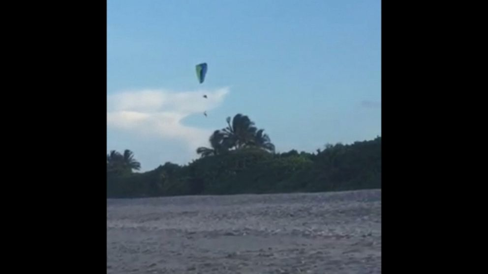 Man's 150-Foot Fall From Paraglider Caught on Video by