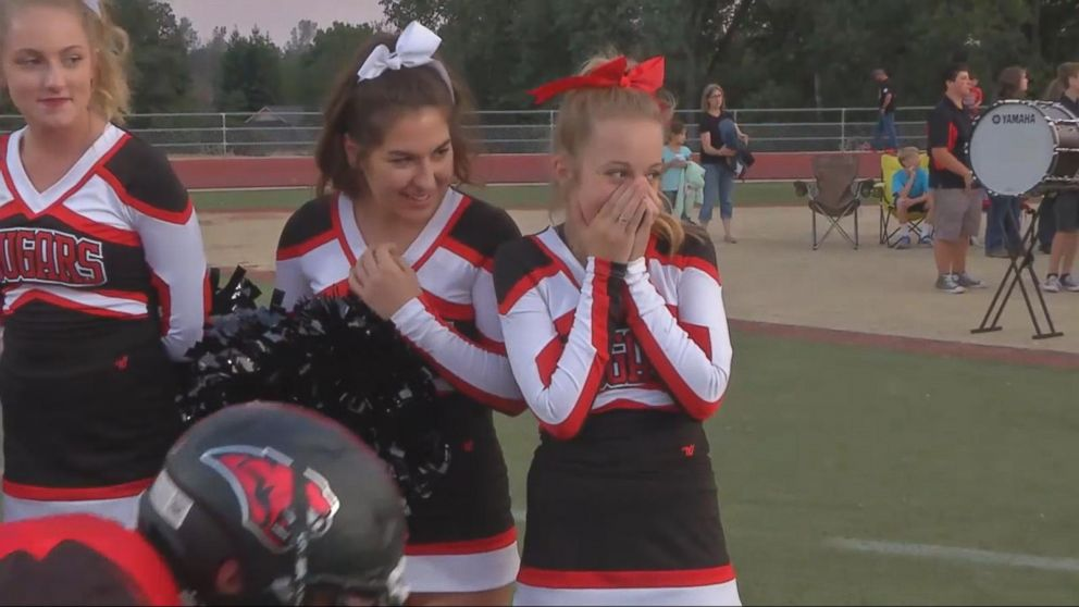 VIDEO: Cheerleader Gets Unexpected Show of Support from High School Football Team