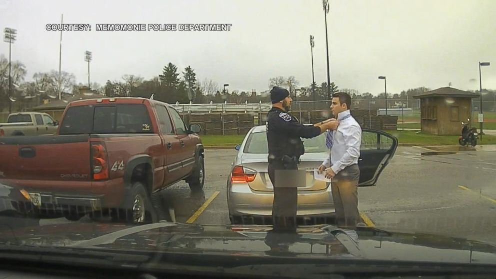 Officer Pulls Over Speeding Student, Teaches Him to Tie a Tie