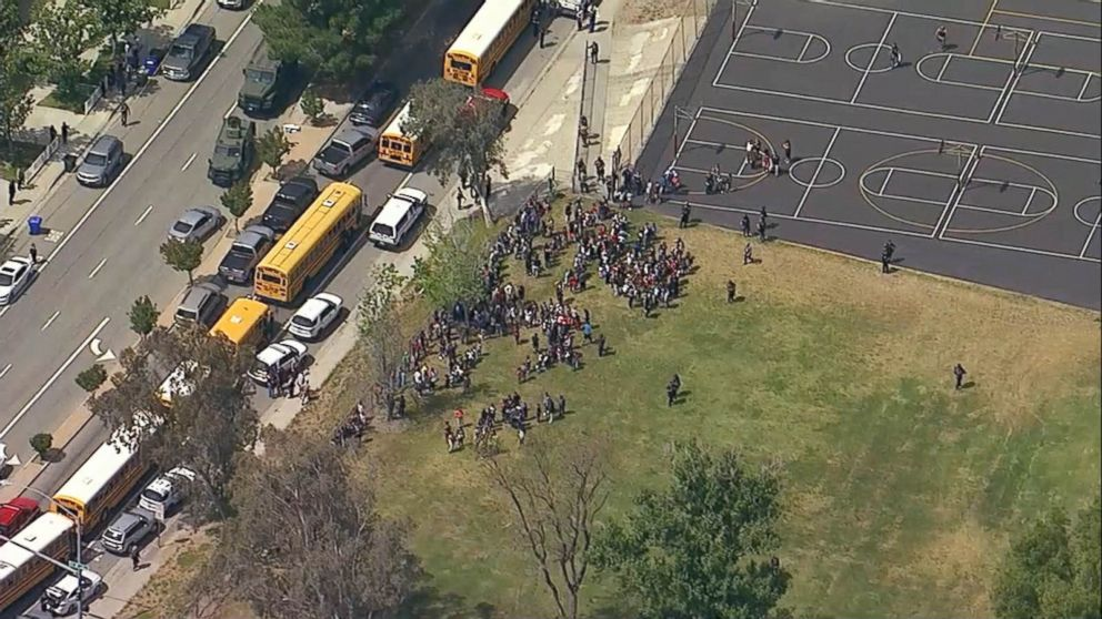 Helicopter footage shows students gathered outside North Park Elementary School in San Bernandino, California following a shooting, April 10.2017.