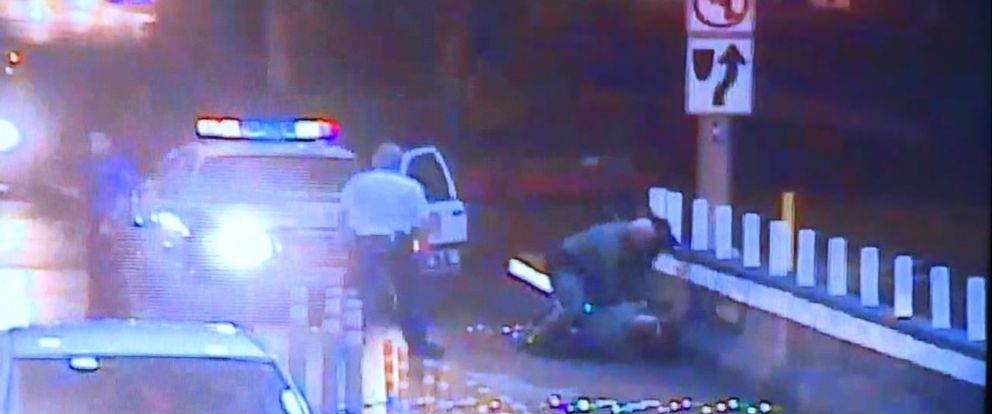 VIDEO: The officer said he believed Tashii Farmer, 40, was trying to break into a car.