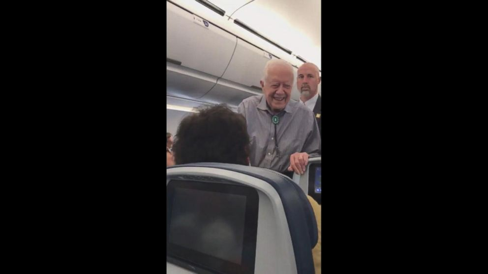 Jimmy Carter shakes hands with every passenger on his flight