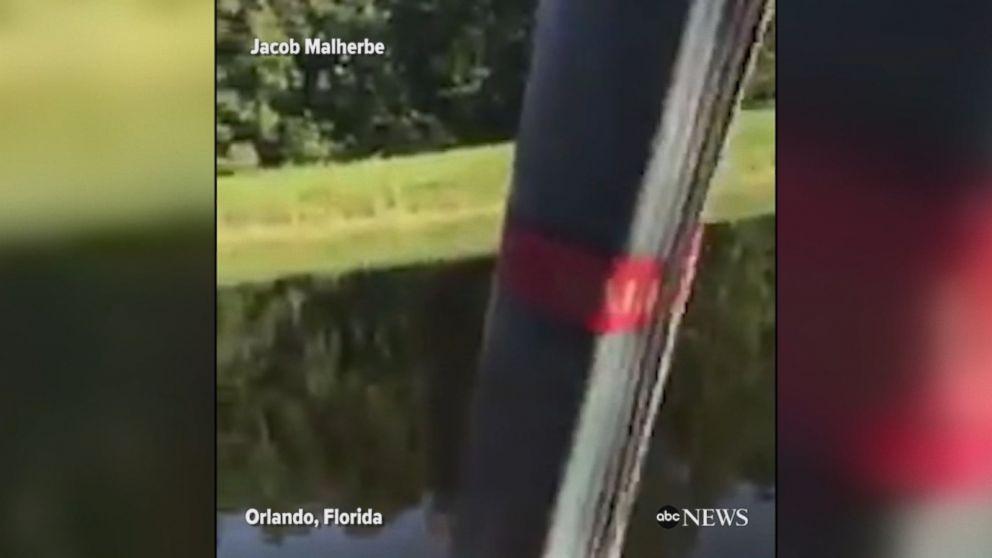 Hot air balloon crashes into Orlando pond