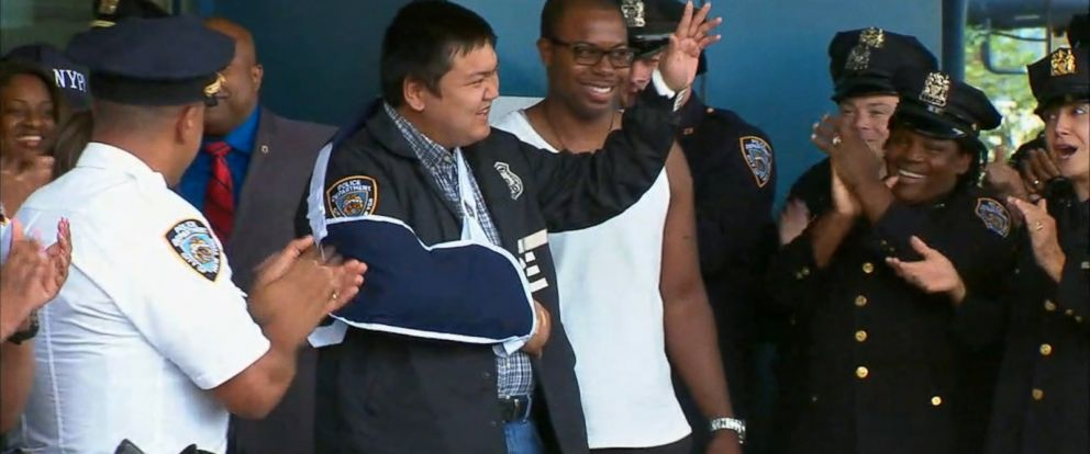 Hundreds of New York Police Department officers and staff members stood, shoulder to shoulder, as 30-year-old officer Hart Nguyen left Jamaica Hospital Medical Center today.