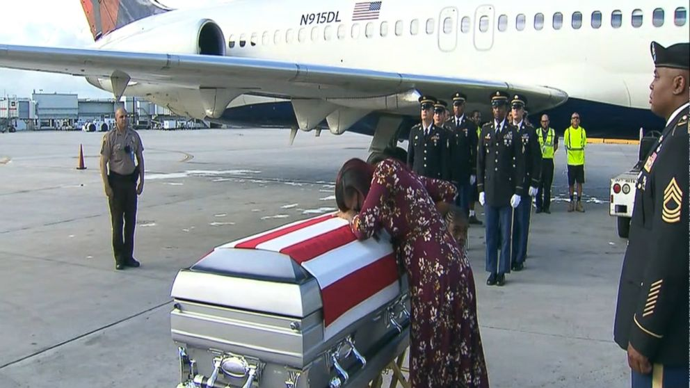 Fallen soldier's widow weeps as casket returns home