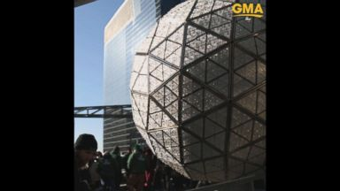 now playing workers finish installing crystal panels in 2018 times square new years eve ball