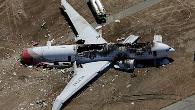 PHOTO: A Boeing 777 airplane lies burned on the runway after it crash landed at San Francisco International Airport July 6, 2013 in San Francisco.