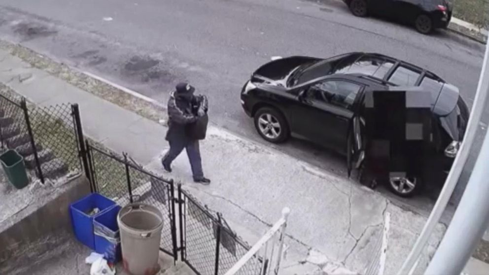 Caught on video: Home-invasion suspect disguised as mailman pulls a gun on victim