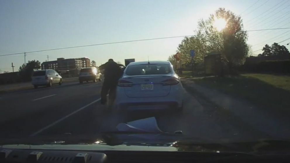 Suspect Flees Traffic Stop After Police Officer Lands In Car Video - In car