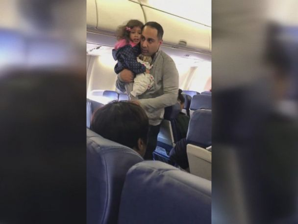 WATCH:  Video shows father and toddler being kicked off plane