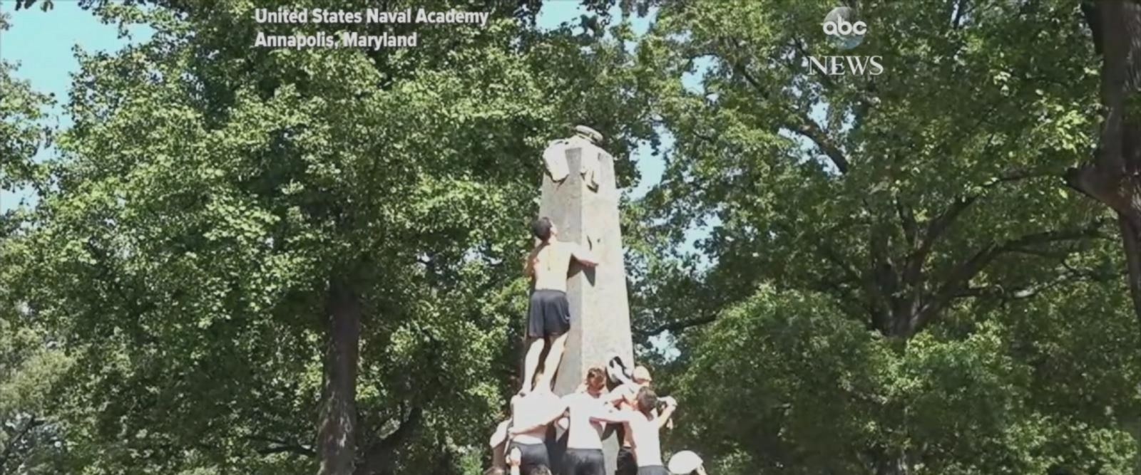 First-year students at the Naval Academy participate in Herndon Climb tradition.
