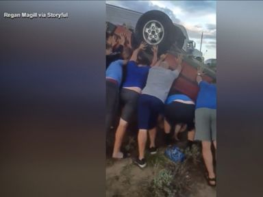 WATCH: Youth football team frees woman from flipped car