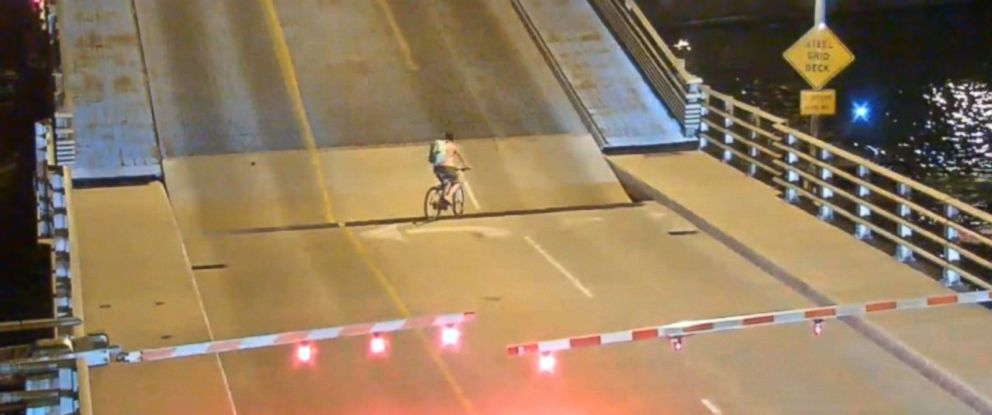 VIDEO: Video shows the woman cycling past warning gates on the Racine Street Bridge in Menasha, Wisconsin.