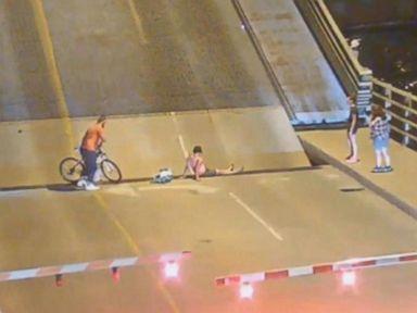 WATCH:  Bicyclist falls into gap in drawbridge