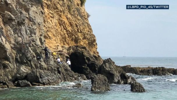 VIDEO: The 15-year-old boy was injured when a boulder fell on top of him at Laguna Beach, California.