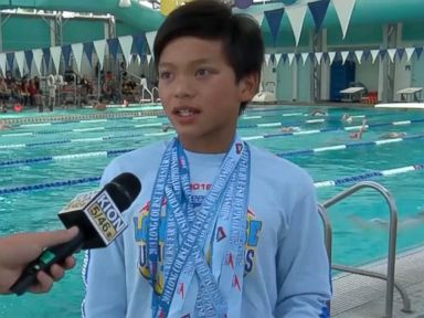 WATCH: 10-year-old swimmer beats Michael Phelps' record