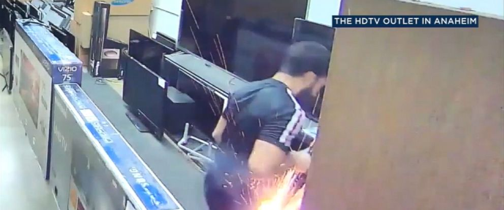 VIDEO: The incident was caught on surveillance video and shows the man shopping for televisions in a store Monday when suddenly flames burst from his pants, burning part of his clothing off.