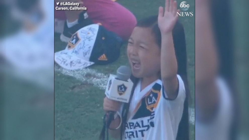VIDEO: Young girl wins over MLS crowd with national anthem rendition