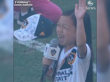 WATCH:  Young girl wins over MLS crowd with national anthem rendition