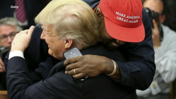 Kanye West hugs President Trump and ABC News' Johnathan Karl in the Oval Office