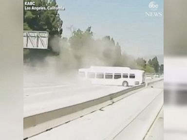 WATCH:  Bus crosses freeway divider and plows into car