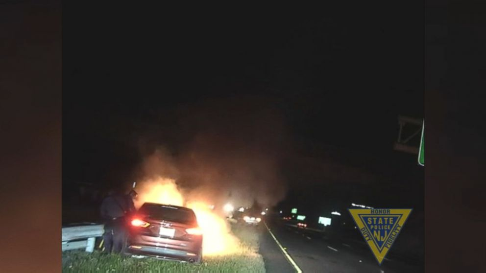Two troopers rescued the man moments before his car became fully engulfed in flames.
