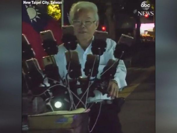 WATCH:  70-year-old Pokemon Go fan plays the game on 15 phones attached to his bicycle