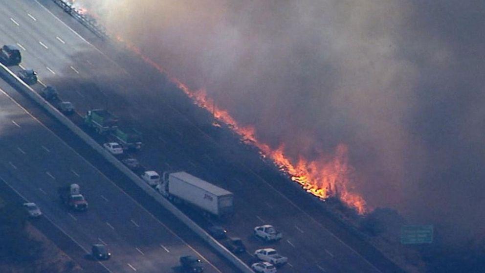 California firefighters battle 'peak fire' near highway amid continuing destruction