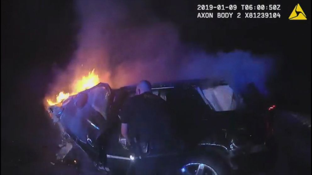 Image result for Bodycam Shows Police Rescue Man From Burning Car