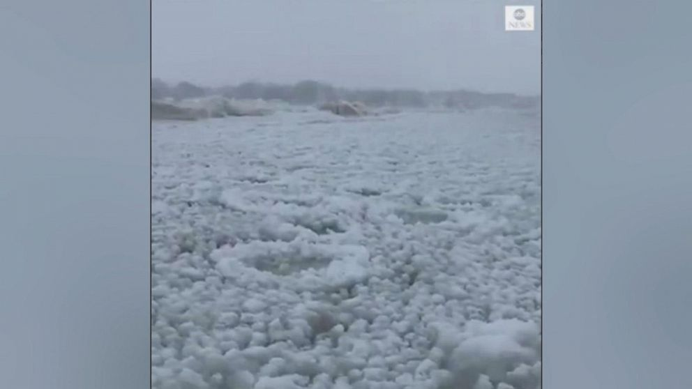 VIDEO: A layer of ice sits atop Lake Michigan and nearby St. Joseph River as brutally cold and extremely dangerous below-zero wind chills paralyze the Midwest.