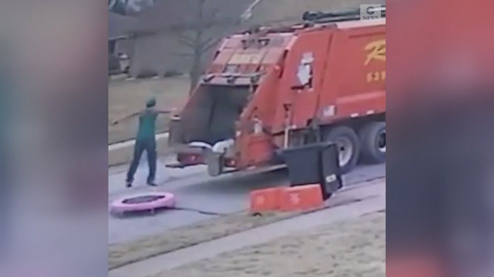 VIDEO: This trash collector was captured on video jumping on a trampoline left by the side of the road for trash pickup.
