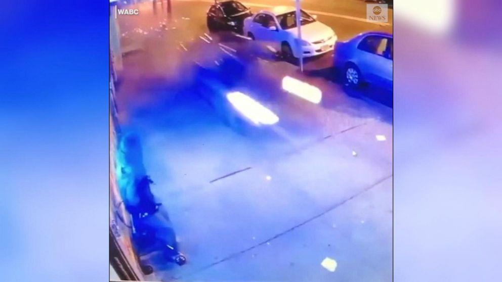 Car speeds down sidewalk, plows into light pole