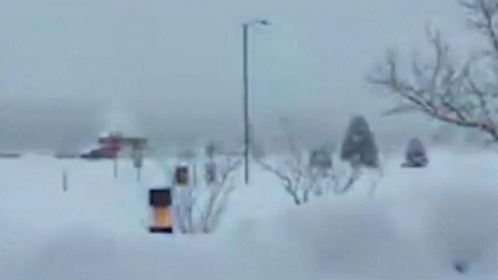 Snow piles up outside the National Weather Service office in Arizona