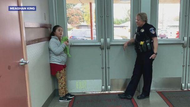Heartwarming moment officer sings to scared girl
