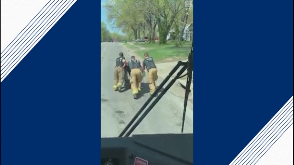 Firefighters pull over to help veteran in wheelchair