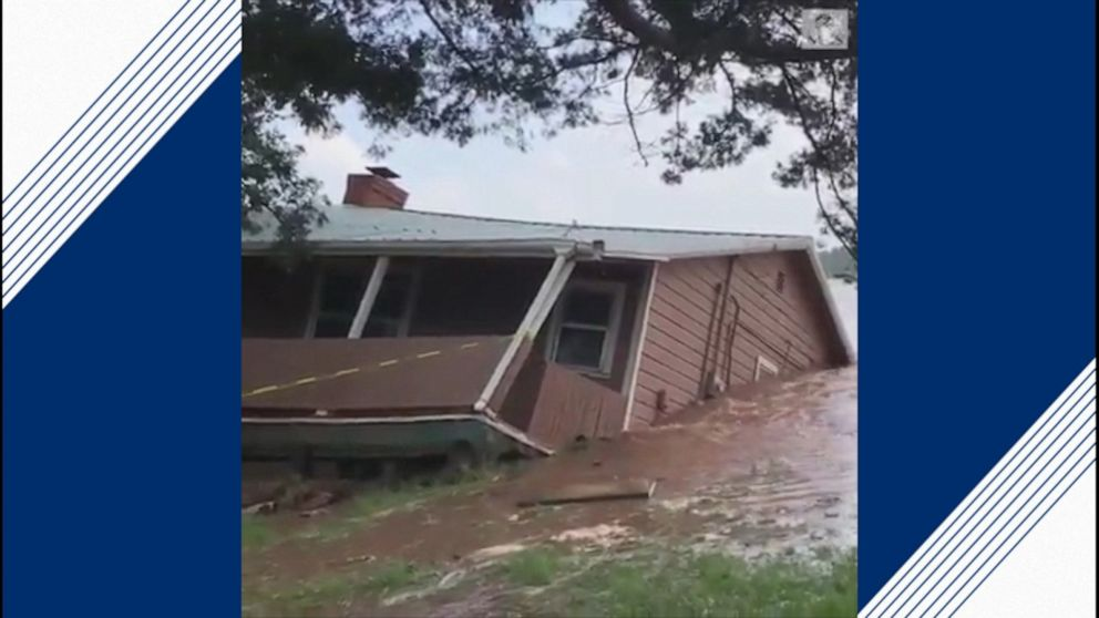 Home swept away by floodwaters