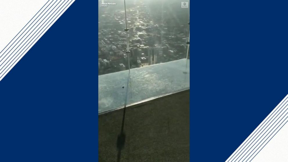 Cracks appear on floor of glass viewing