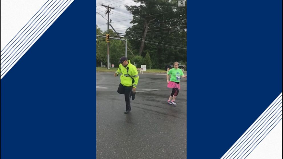 Police officer shows off dance moves during race
