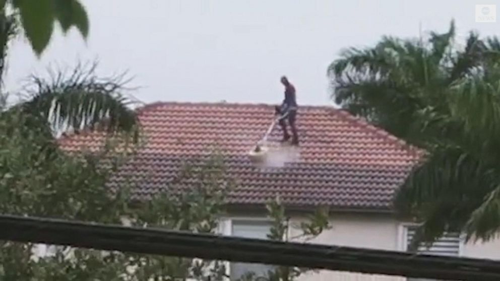 Spider-Man cleans rooftop in Florida
