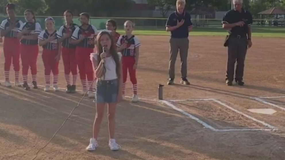 Young girl wows crowd with national anthem at ballgame