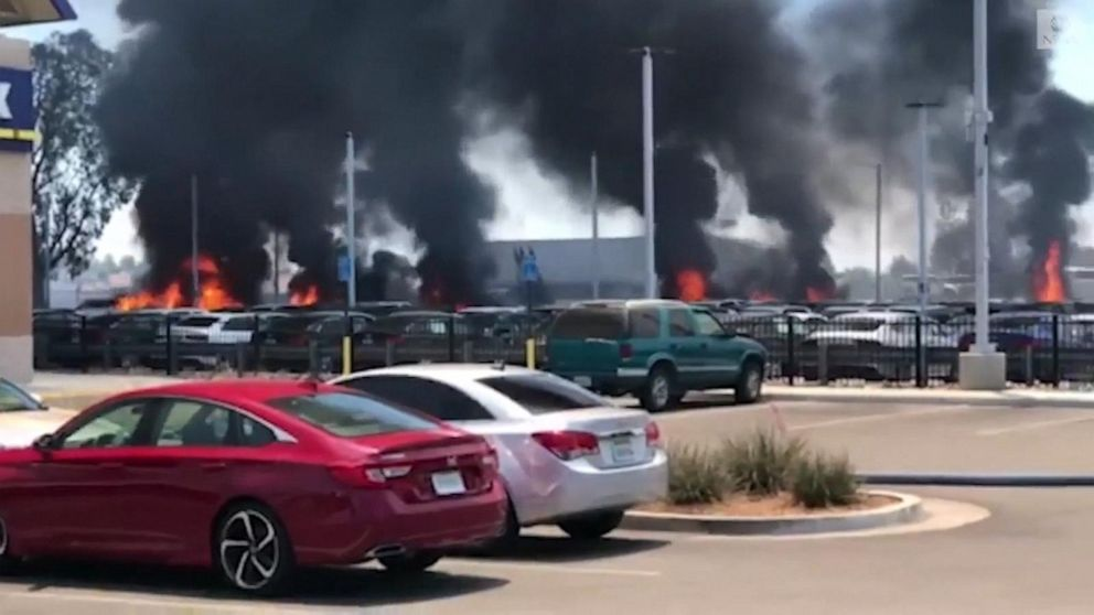 California fire spreads to car dealership lot