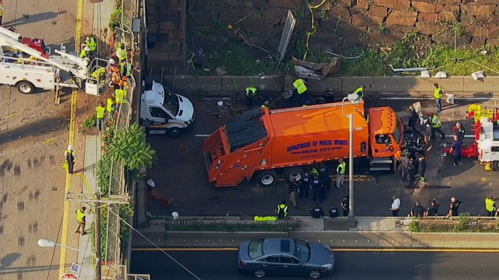 Garbage truck overturns near NYC Lincoln Tunnel, injuring at least