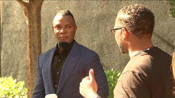 Parents of alleged R. Kelly victim interrupt news conference after arrest