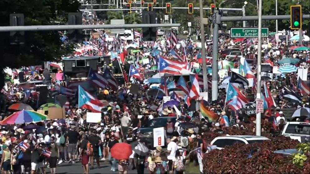 Tens of thousands of protesters shut down freeway in Puerto Rico; demand governor's resignation